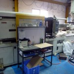 An enormous injection molder. On the right is the hopper where the plastic chips are inserted. Then a giant heated screw moves and melts the plastic forward. The tool is next, then the hydraulic press holds the two halves of the tool together while the plastic is injected and cooled. Then the hydraulic part moves back and the pins push the part out.